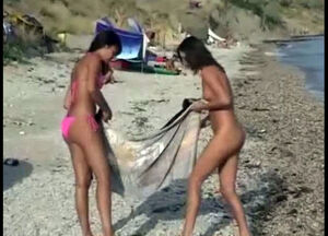 Topless teens at beach